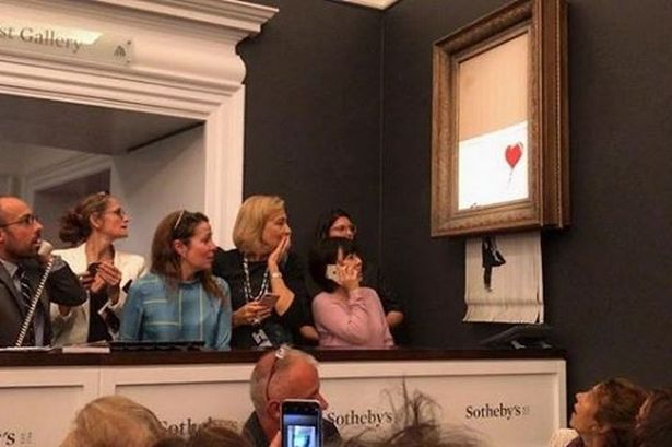 0_Banksy-destroys-his-artwork-seconds-after-it-sold-for-£1-million